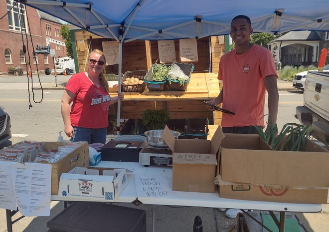 Growing Places volunteer Dana Spinney and TerraCorps service member Derek Alford provided a plethora of fresh produce at the organization's booth — including tomatoes, beets, apples, carrots, and more from farms across the state — at the first day of the Leominster Farmers Market 2021 season on Saturday, June 5.