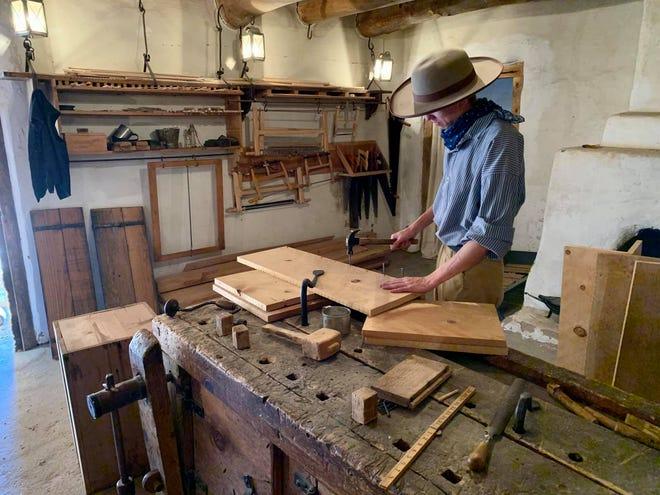 Living historian Bradley Mills doing carpentry work at Bent's Old Fort National Historic Site.