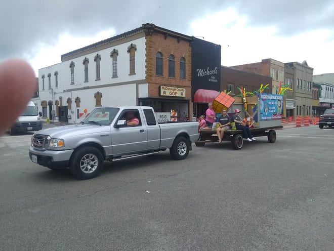 The Maple Avenue Christian Church vacation bible school float is seen during the Mayor Bob Anstine Memorial Parade Saturday morning during the Macomb Heritage Days festival..