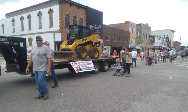 The International Union of Operating Engineers Local 649 walked between vehicles and heavy equipment during the Heritage Days parade Saturday morning.
