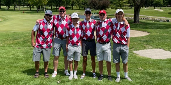 Bedford coach Brad Reed (second from left) poses with Bedford's boys golf team. Reed has been named the 2021 Monroe County Region Golf Golf Coach of the Year.