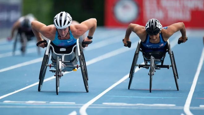 Paralympic wheelchair  racer Cheri Madsen, right, battles  against Tatyana McFadden in the 400 meters at the U.S. Trials.