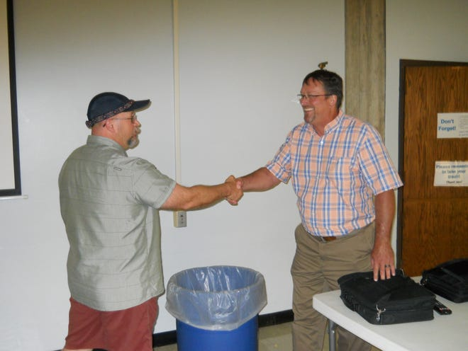 Nathan Mullins, a concerned citizen about the pool shakes hands with, from left, Recreation and Parks director Jon Hetrick after a Recreation and Parks Board meeting. Mullins said there was 'a lot of trepidation about who is trying to take control of the project' regarding the pool.
