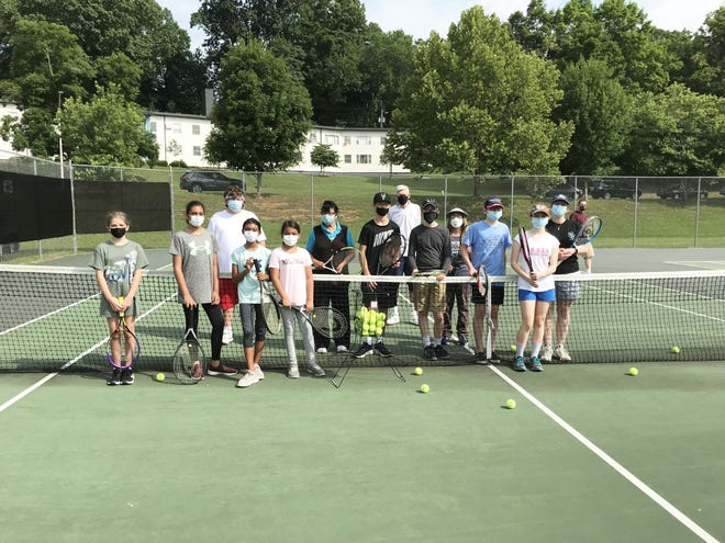 Pictured are many of the June participants and senior facilitators. July tennis sessions will take place each Friday, from 9 to 10 a.m. at the Jackson Square tennis courts.