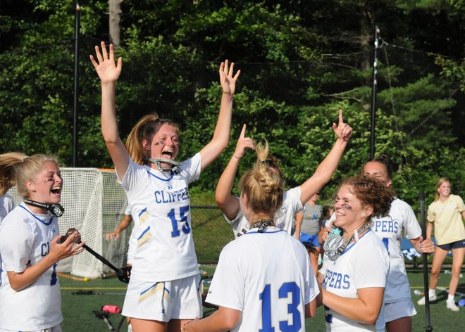 The Norwell High girls lacrosse team jumps for joy after defeating Cohasset in the Division 2 South Sectional final.
