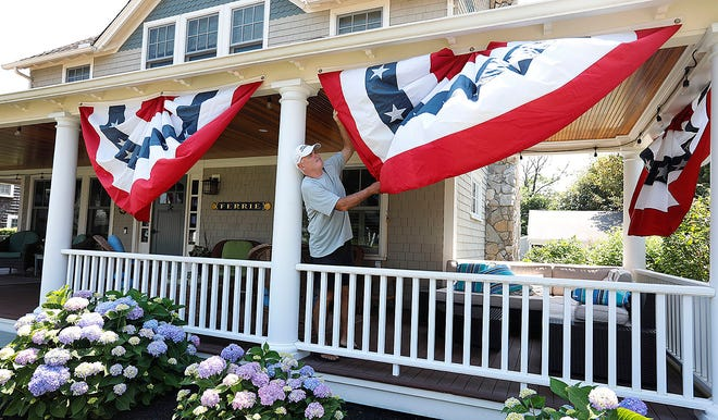 John Ferrie of North Scituate will have friends and family for the holiday, and he's making sure his house is decorated for the occasion.