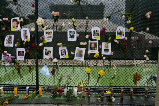 A view of a make-shift memorial on Jun 26, 2021, near the site where a 12-story condo building partially collapsed in Surfside, Florida.