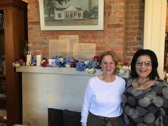 Travis and Kathryn Campesi decorated the Iberville Parish Museum mantle using a red, white andblue theme for the summer.