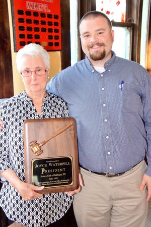 Joyce Waterfill handed over the reins of the Ballinger Rotary Club to First National Bank of Ballinger vice president Tyler Reasor. Waterfill was given a plaque to show the club's appreciation. Waterfill steadfastly guided the club through the pitfalls of COVID-19 from 2020-2021. Reasor will serve as president of the club from 2021-2022.