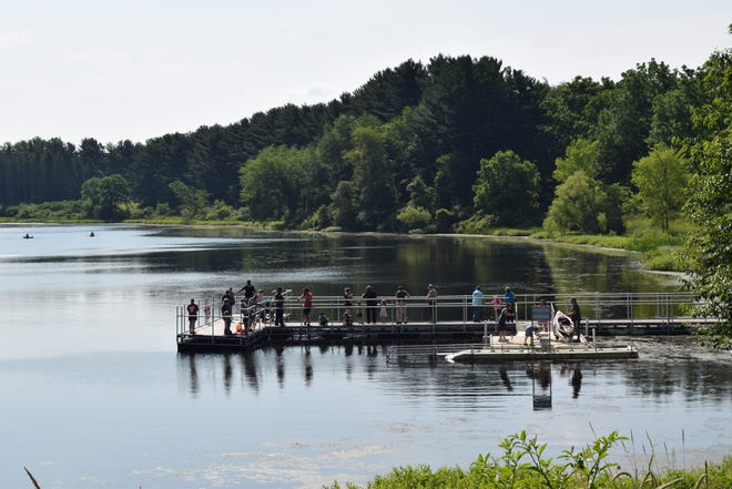 About 20 children and parents tried their hand a fishing on Saturday with the help of Portage law enforcement officers during a Portage Park District event at Trail Lake Park in Streetsboro.