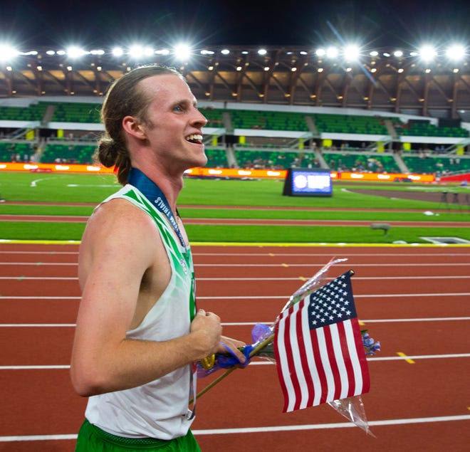 Oregon's Cole Hocker takes a victory lap after winning the men's 1,500-meter title at the U.S. Olympic Track & Field Trials at Hayward Field in June.