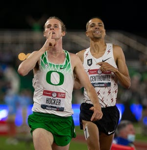 Oregon's Cole Hocker, left, gestures to the crowd as he edges former Duck Matthew Centrowitz, right, for the win in the men's 1,500 meters at the U.S. Olympic Track & Field Trials at Hayward Field in June.
