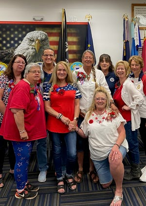Members of the Mooresville American Legion Auxiliary, including Julie Short, Cindy Kelly, Mary Ferling, Sabrina DeGolyer, Sonja Sprowl, Anita (Gail) Mann, Tammy Snell-Stover, Julie John and Sharon Regnier, pose for a photo.