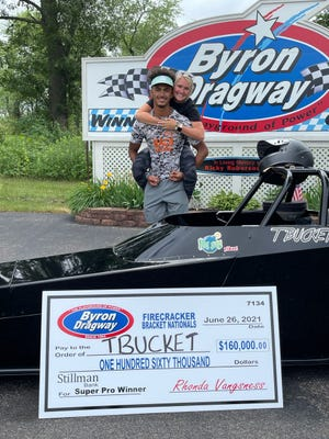 TC Williams, 20 of Winnebago, poses with his girlfriend, Logan Knause, Sunday after winning the most expensive race in Byron Dragway history, worth $160,000.