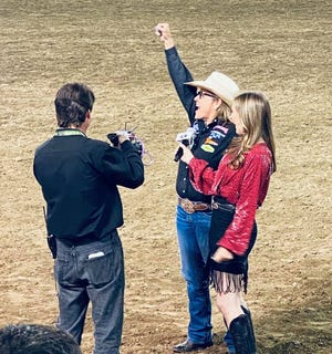 While being interviewed, Stephenville's JJ Hampton reacts to the news of winning the women's breakaway roping title on Saturday at the Reno Rodeo in Reno, Nevada.