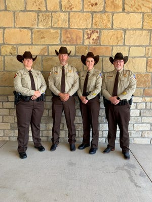 Sheriff Matt Coates, second from left, was on hand to address the graduating class at Weatherford College Law Enforcement Academy when new Erath County deputies Angela Williams and Kim Johnson completed their six-month law enforcement academy program.