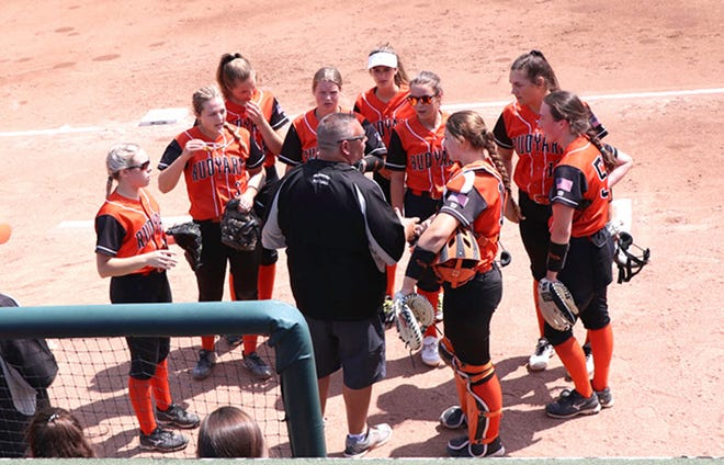 A group of Rudyard players gather around coach Stephen Davis during a semifinal game at Michigan State. Rudyard's Paige Postma (3) and pictured at far right, Morgan Bickel (52) have been selected to play in the Michigan High School Softball Coaches Association Senior All-Star Game. Davis was also chosen as one of the All-Star Game coaches.