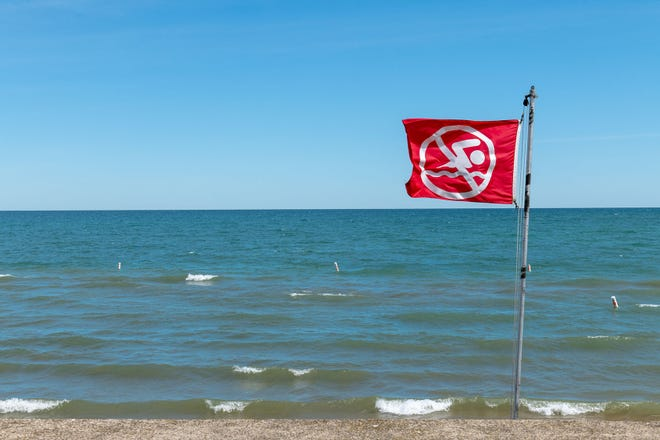 A red flag flying at Albert E. Sleeper State Park, warning swimmers to not enter the water.
