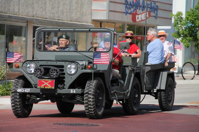 Veterans proceed down Main Street during a prior Independence Day parade in Shawnee. FILE PHOTO