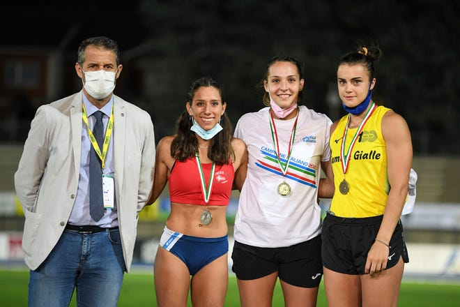 Washburn's Virgi Scardanzan (second from left) finished runner-up in the pole vault at the Italian National Championships over the weekend.