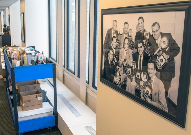 A photograph of Worcester Telegram staff photojournalists from the 1950s hangs in the T&G newsroom that is being transformed for movie production.