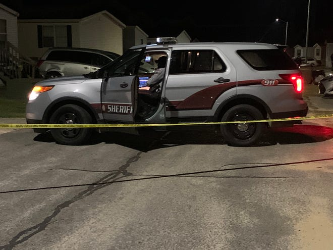 A Cumberland County Sheriff's Office vehicle is behind crime scene tape May 15 on Spearfish Lane while law enforcement investigates the shooting death of Daniel Sulton. Twin brothers from Gibsonville have been jailed in the slaying. A third man is being sought.