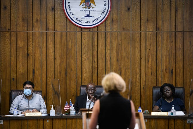 From left, Mayor Pro Tem Taimoor Aziz, Mayor Larry Dobbins and Alderwoman Jackie Jackson listen to Susan McCullen, the Local Government Commission's director of fiscal management section, as she speaks at Spring Lake's Board of Aldermen during a budget meeting on June 28.