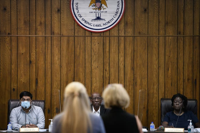 Mayor Pro Tem Taimoor Aziz, Mayor Larry Dobbins and Alderwoman Jackie Jackson listen to Susan McCullen, the Local Government Commission's director of fiscal management section, as she speaks at Spring Lake's Board of Aldermen during a budget meeting on Monday, June 28, 2021.