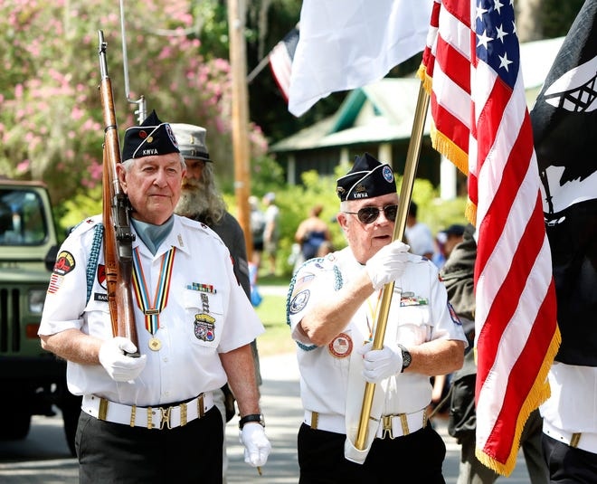Korean War veterans march along the parade route during the annual Micanopy Fourth of July Parade in 2019.