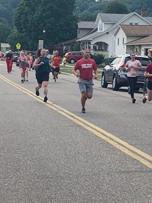 Runners take off during the Tusky Days 5k Run on Friday evening. TIMES-REPORTER/CINDY DAVIS