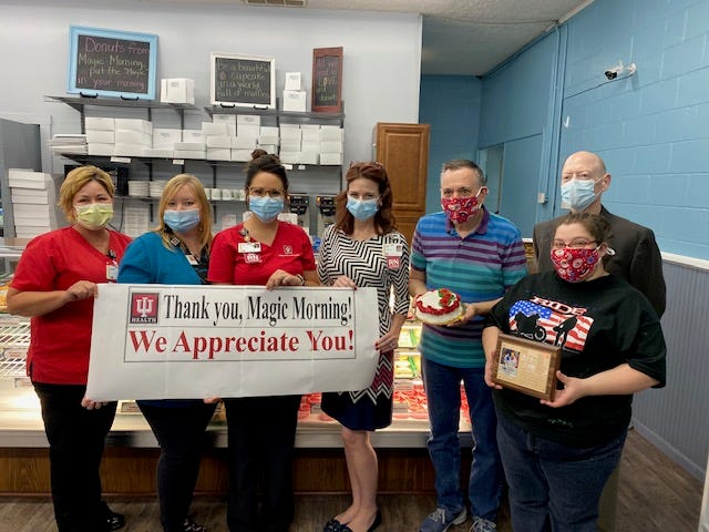 From left: Diana Friedman, clinical manager of IU Health Bedford oncology; Sarah Lynch, infusion scheduler; Mackenzie Patton, RN, CNN, Amy Little, DNP, RN, Chief nursing officer, Magic Morning owner Scott Stroud, Candice Kirtley and Brad Dykes, IU Health Bedford CEO.