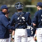 Navy pitching coach Bobby Applegate discusses strategy on the mound. Applegate has been named the new head baseball coach at Colorado State University Pueblo. [Courtesy photo/Navy athletics]