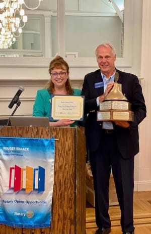 Rotary Club District 7910 Gov. Diana Nestorova presents Rotary Club of Weston and Wayland President John Marchiony with Club of the Year honors