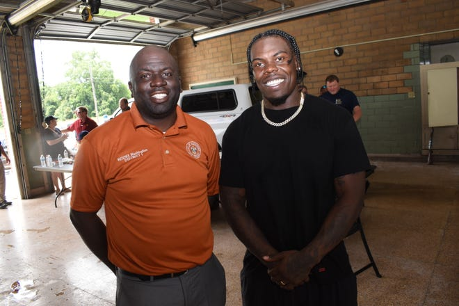 Jalen Richard (right), running back for the Las Vegas Raiders and a former Peabody Magnet High School football player, and City Councilman for District 1 Reddex Washington, Jr., hosted a gun buyback Sundat at the fire station on Broadway.