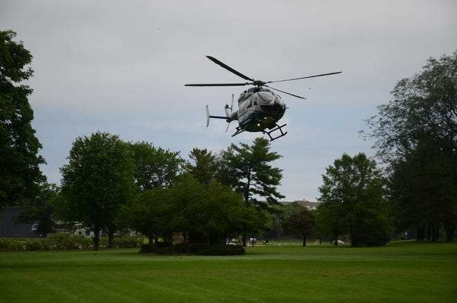 A West Michigan Air Care Medical Helicopter lands at Kellogg Community College Monday for training.