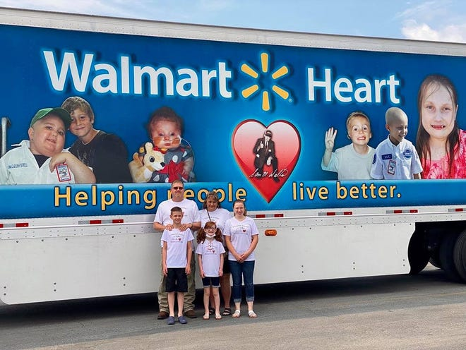 Willow Remy, middle, is a 10-year-old from Vinton County living with Hypoplastic Left Heart Syndrome and severe cardiomyopathy. She was celebrated by volunteer-run organization Walmart Heart at the box store's Chillicothe location on Saturday, June 26.