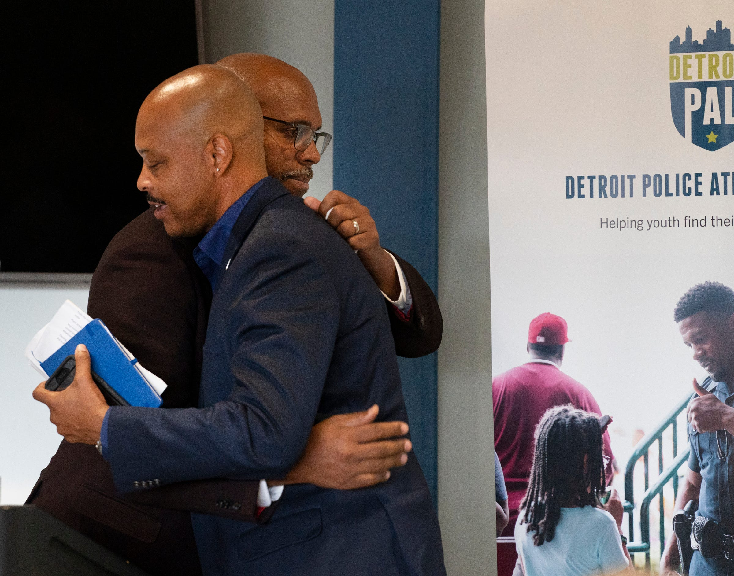 Detroit Police Athletic League (PAL) Director of Programs and Operations David Greenwood, left, hugs PAL CEO, Robert Jamerson as they celebrate some good news from the state of Michigan Monday, June 28, 2021. Legislators from the Michigan House of Representatives announced a new $15 million commitment to PAL, specifically PAL's new Community Connection Initiative.