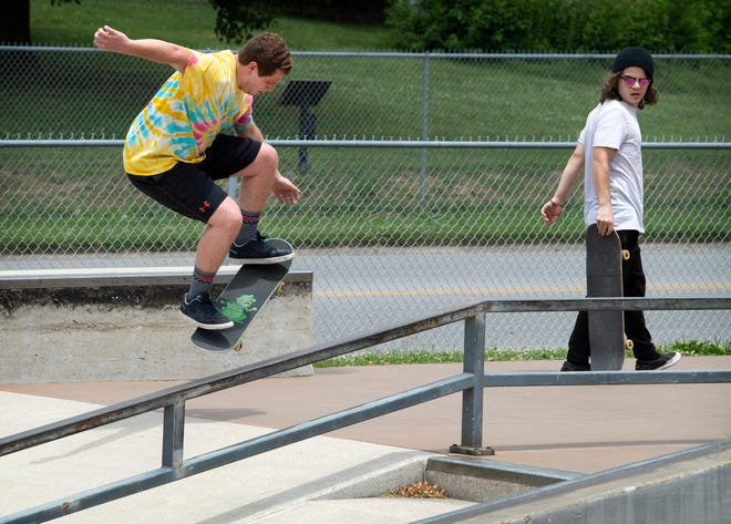 Ryan Perry, left, Ollies near his friend, Alex Lindsey at Travis Aubrey Skate Park in Chautauqua Park in Owensboro, Ky., Saturday afternoon, June 26, 2021. The group of friends make regular trips from their home stomping grounds of Beaver Dam, Ky., to skateboard in other Kentucky skate parks including Owensboro, Madisonville, Bowling Green and Hopkinsville after picking up the sport around the beginning of the COVID-19 pandemic.
