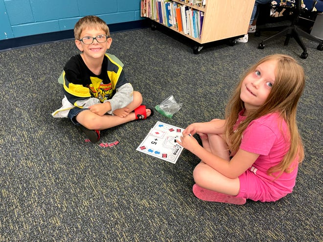 Dawson Pickens and Emma Widmer play a math game at Bataan Memorial Primary's Excel Academy.