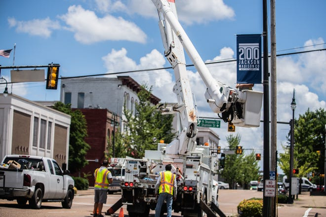 The city of Jackson maintenance crew will be installing about 75 Bicentennial flags for the next three days, starting on Monday, June 28, 2021 in Jackson, Tenn in preparation for Jackson's Bicentennial Celebration.
