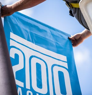 Michael Earney, city of Jackson maintenance crew member, installing a Bicentennial flag on Monday, June 28, 2021 in Jackson, Tenn. About 75 Bicentennial flags will be installed in downtown Jackson for the next three days in preparation for Jackson's Bicentennial Celebration.