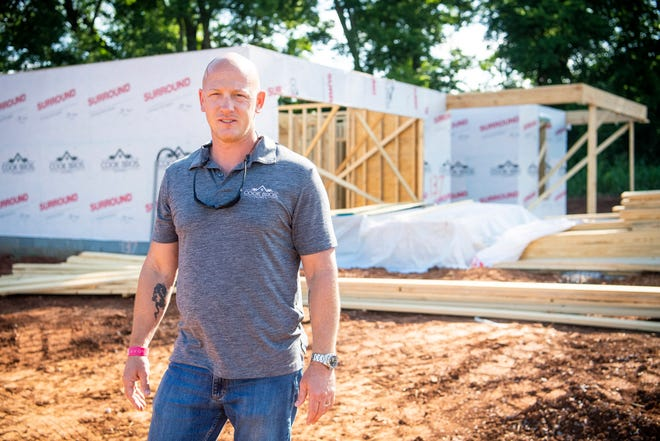 John Cook, president and CEO of Cook Bros. Homes, is photographed at the site of a home currently under construction in The Grove at Cedar Hills subdivision in Lenoir City on Monday, June 28, 2021. Cook is facing unprecedented challenges as a home builder, including supply delays, lack of workforce and unpredictable costs.