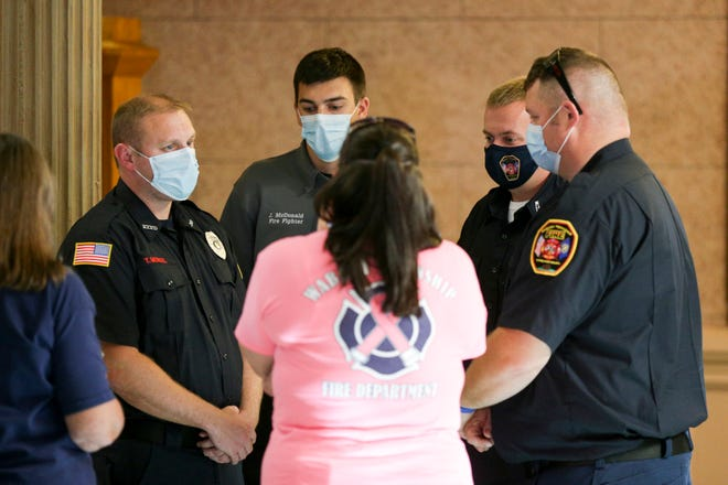 Wabash Township firefighters talk in the hallway after a hearing in Tippecanoe County Civil Court, Monday, June 28, 2021 in Lafayette.