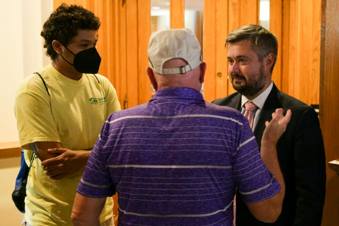 Ray Biederman, Wabash Township Trustee's office attorney, right, talks with Deputy Chief Jim Lewis, center, and board member Brendan Betz, left, after a hearing in Tippecanoe County Civil Court, Monday, June 28, 2021 in Lafayette.