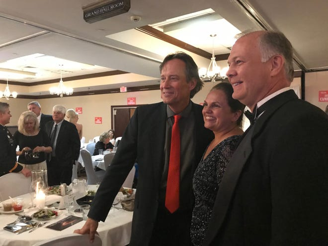 Kevin Sorbo, left, star of Chosen, a film about foster care and adoption, filming in Mansfield, posed with guests for photos Sunday  night at the downtown Holiday Inn & Suites.