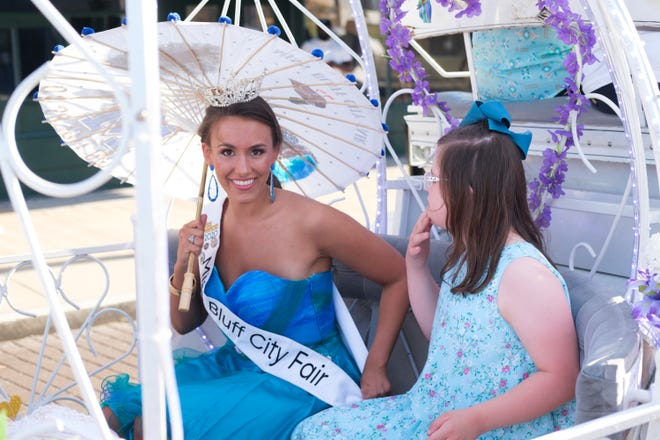 Lydia Fisher sits in a carriage during the Miss Tennessee Scholarship Competition's Show Us Your Parasol parade on Beale Street, Sunday, June 27, 2021 in Memphis, TN.