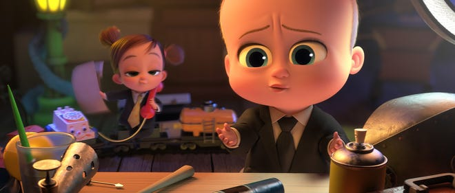"""Tina Templeton (left, voiced by Amy Sedaris) and the Boss Baby/Ted Templeton (Alec Baldwin) confer in """"The Boss Baby: Family Business."""""""