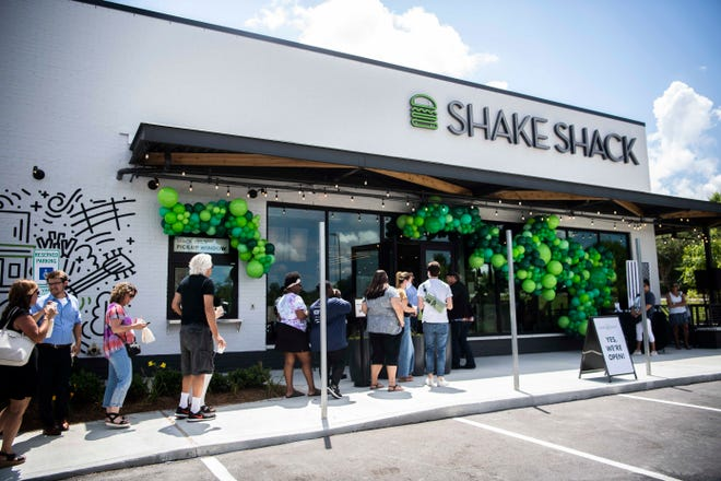 Customers line up in front of the Shake Shack restaurant in Franklin, Tenn., Monday, June 28, 2021.