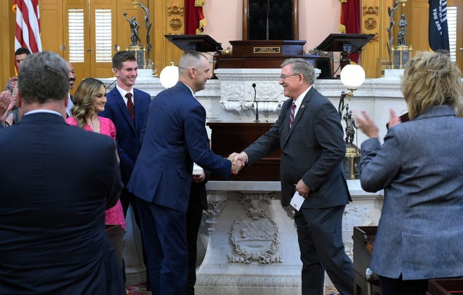 Kevin Miller, left, shakes hands with Ohio House Speaker Robert Cupp after being sworn in on Monday, June 28, 2021 to serve as the 72d district representative. Miller replaces the indicted Larry Householder, who was expelled from office earlier in June.