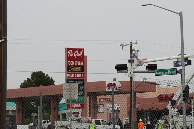 Crews repair a power line on Avenida de Mesilla on Monday, June 28, 2021.